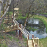 Bridge with nets along a lake