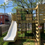 Jungle Gym with slide and climbing net and basketball hoop